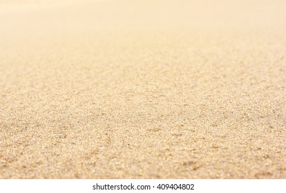 Selective focus of sand on the beach. Close-up of sand with copy space. Focus on the foreground. Sand background.