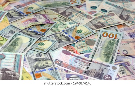 selective focus of Saudi Arabia currency with USA currency and Egypt currency banknotes. blurred money . Saudi Arabia riyals, Egyptian pounds and American dollars exchange rate. - Shutterstock ID 1946874148