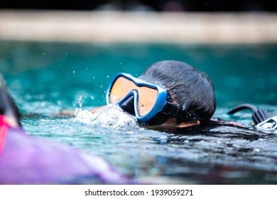 Selective focus to scuba diver training in the pool. A diver practicing diving in the pool.