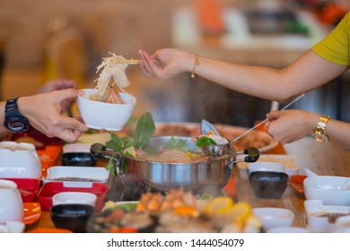 Selective focus Shabu Shabu and Sukiyaki, Japanese food with grill and pot boil