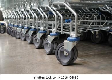 Selective focus of shopping cart wheels, Concept of shopping