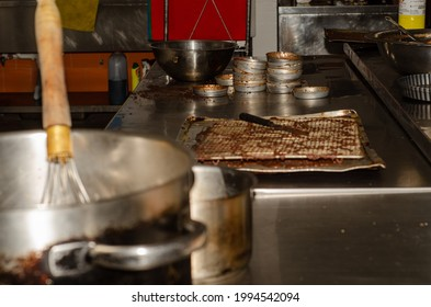 A selective focus shot of dirty pan with cookie molders in a kitchen