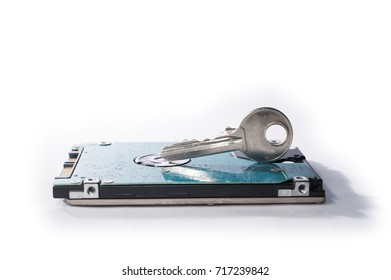 Selective focus shot of a key on hard disk circuit view from side isolated over white background.Data Security Concept.