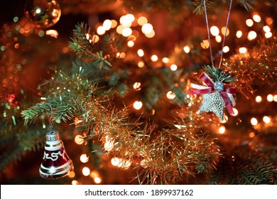 A selective focus shot of ornaments and lights on the decorated Christmas tree