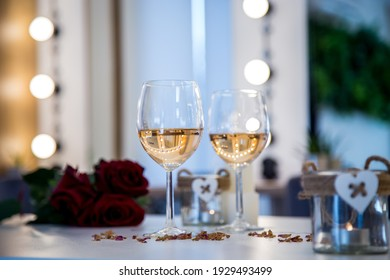 A selective focus shot of two glasses of white wine