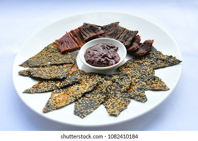 Selective focus the Sin savan(sun-dried beef) whit Khaipen(Fried Seaweed) and Jaew bong(spicy Laos chili dip).