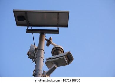 Selective focus, solar cell support power to CC.TV. cameras system on metal pole for saving electricity. Concept of renewable energy, saving energy, saving environment.