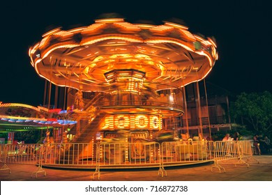 Selective focus to some part flying horse carousel, carnival background with Vintage filter.