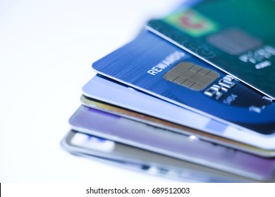 Selective focus, Stack of credit card and debit card on white background.financial background concept.