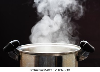 Selective focus steam over cooking pot.hot food