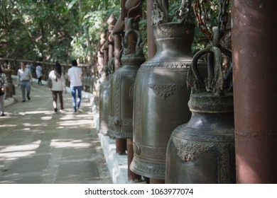 selective focus of steel bell in Thai temple,  Chiang Rai, Thailand