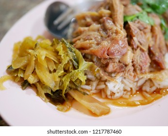 Selective focus of stewed pork leg with pickled cabbage on rice (Kao Ka Moo)