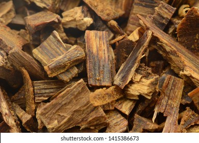 Selective Focus, Sticks Of Agar Wood Or Agarwood Background The Incense Chips Used By Burning for incense & perfumes of essential oil as Oud Or Bakhoor - Image