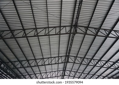Selective focus, structure steel beams support metal sheets for roofing construction. Concept of structure steel, roofing, steel bars.