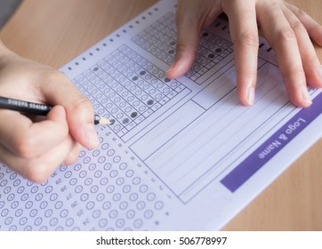 Selective focus Student filling out answers to a test with a pencil.