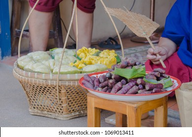 selective focus of sweet potato, purple skin of yam fruit put in basket selling at the Thai market