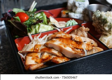 selective focus of teriyaki glazed chicken in a bento box