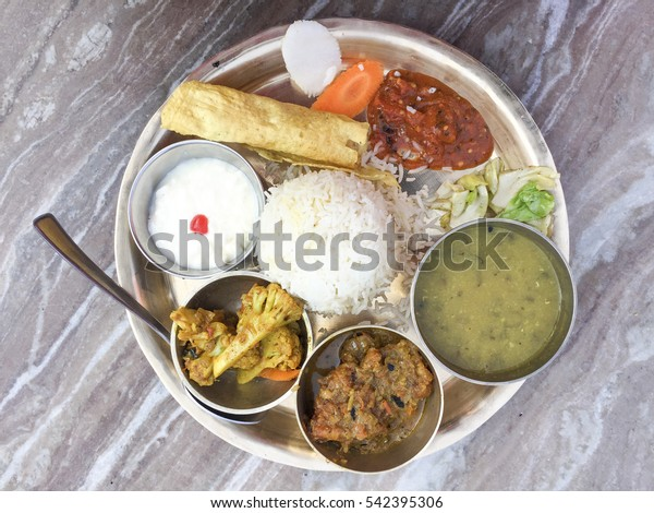 Selective focus of Traditional Nepalese food - Fish Thali or Thakali (dal bhat) in a restaurant.