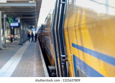 Selective focus of the train with blurred peoples traveling with the train as background, Passenger getting in and out the train in Netherlands.