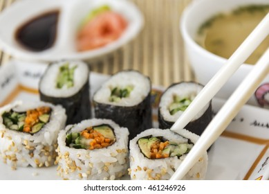 Selective focus was used on this image of vegetable sushi with chop sticks and Japanese clear broth soup