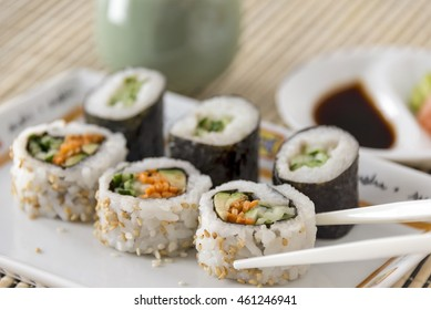 Selective focus was used on this image of vegetable sushi with chop sticks