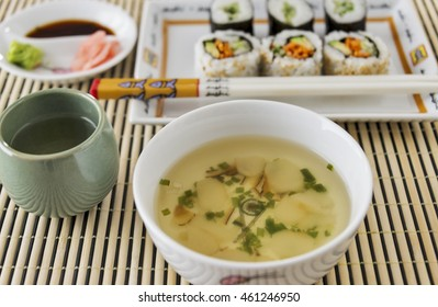 Selective focus was used on this Japanese Clear Broth Soup and vegetable sushi image