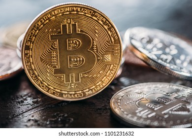 selective focus of various bitcoins on dark surface - Shutterstock ID 1101231632