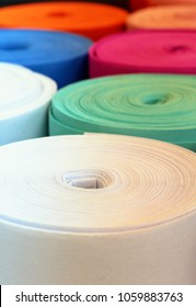 Selective focus view of colourfu rolls of felt