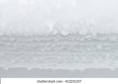 selective focus Water dripping from ice refrigerator freezer