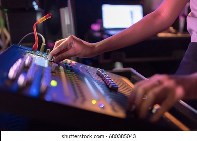 In selective focus of woman dj Mixes the track sound equipment in the nightclub at party