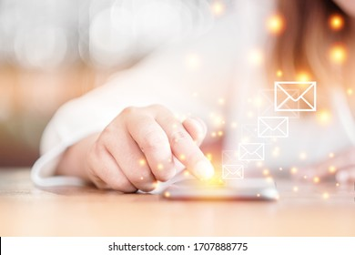 Selective focus woman hand with Messages icons on smartphone screen. Communication Email concept.