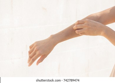 Selective focus Woman scratch the itch with hand, Arm, itching.Concept with Healthcare And Medicine.