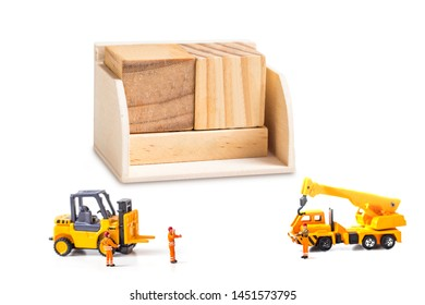 selective focus of wooden calendar and  miniature workers man isolated on white background, creative image for holiday concept.