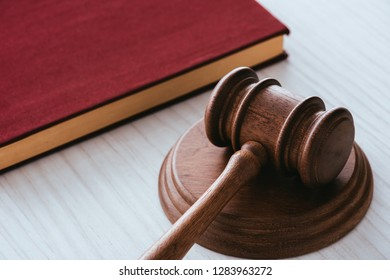 selective focus of wooden gavel near notebook on table