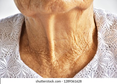 selective focus wrinkled and freckled skin Of eldery asian women.The skin that is wrinkled on the neck.Body that has deteriorated.Beauty problems of older women.eldery health concept.
