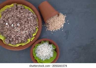 Selective focused, Red chamba Puttu with coconut. Puttu is a South Indian and Sri Lankan breakfast dish which is steamed cylinders of ground rice layered with coconut. Healthy South Indian breakfast.