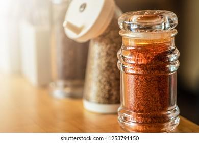 selective focused of set of Japanese seasoning for ramen, chilli, sesame and black pepper