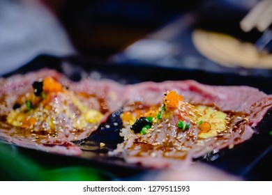 Selective focust to set of grilled Wagyu beef sushi with fish roe and Tobiko on black plate in Japanese restaurant. Japanese food, Wagyu beef, fish roe
