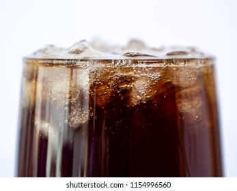 Selective fucus of cola soft drink with ice in the glass on isolated / white background