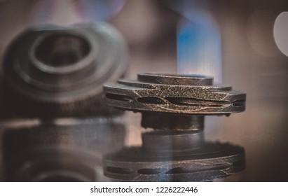Selective Laser Melting. Object printed on metal 3d printer. Model created in laser sintering machine. DMLS, SLM, SLS technology. Concept of 4.0 industrial revolution. Progressive additive technology.