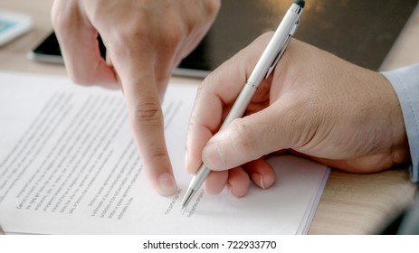 The selective and soft focused image of businessman is going to sign the contract in the business meeting.