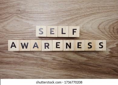 Self Awareness alphabet letter on wooden background