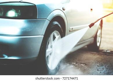Self Car Washing on a Backyard. High Pressure Washer