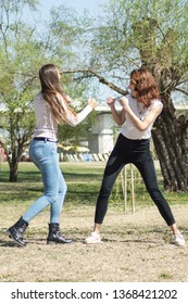 Self Defense - Two attractive beautiful young woman, boxing