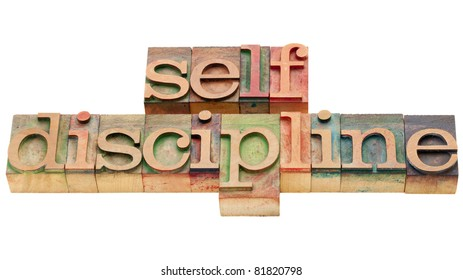 self discipline - isolated text in vintage wood letterpress printing blocks