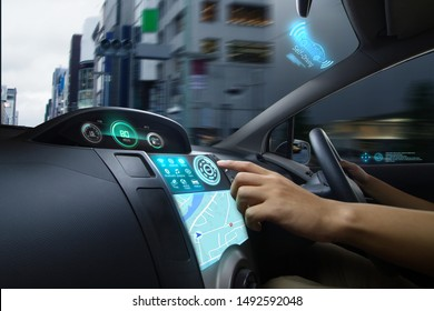 Self Driving car with futuristic graphic of GPS system driving on street in the city with Autopilot Mode. AI Technology with transportation concept.
