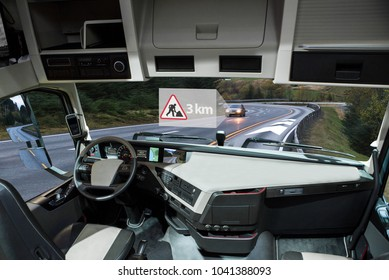 Self driving truck on a road. Vehicle to vehicle communication. Data exchange between autonomous cars.