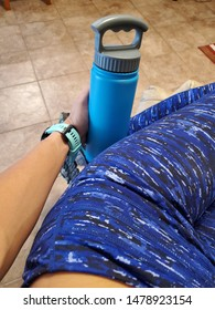 Self Holding Blue and Grey Water Bottle Wearing Workout Pants