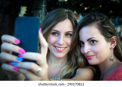 self ie, two young pretty girls make a photo of themselves