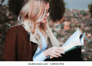 Self improvement and education concept. Female self improvement. Girl relax in park sit on grass. Business lady find minute to read book improve her knowledge.Relax leisure an hobby concept.